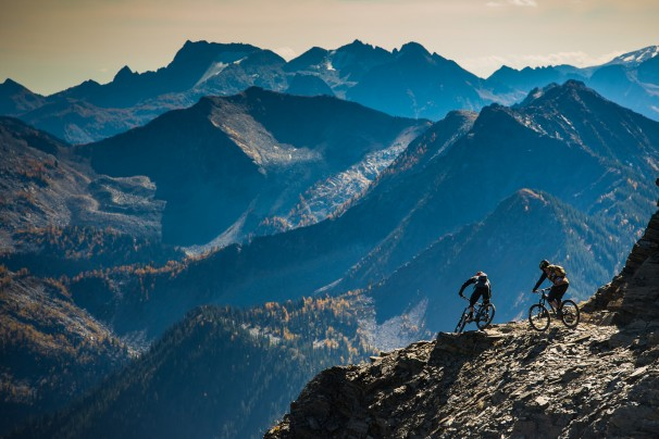 Fearon and Aggy dropping in off the 8,300 foot summit of Reco Peak. Located about an hour's drive north of Nelson, BC, which lies in the south-central part of the province, it's easy to see why Retallack has quickly become one of the top backcountry mountain bike destinations on the planet. Photo Blake Jorgenson